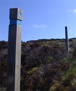 Walking tourist signpost
